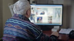 Eldery man working on a computer Stock Footage