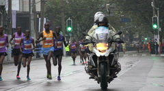 Leading front runners, Shanghai marathon, popular sporting event in China - stock footage