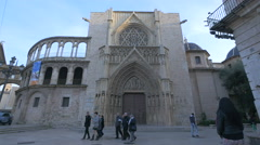 People walking in front of the Apostles' Doorway of Valencia Cathedral Stock Footage
