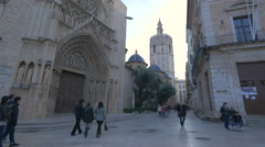 People walking by the Apostles' Doorway of Valencia Cathedral Stock Footage