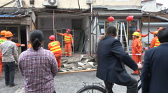 China, Shanghai, workers remove homes shops, dispossession, property, rights Stock Footage