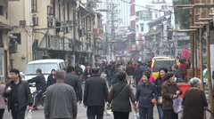 Old neighborhood Shanghai, busy street, people walking, community China Stock Footage