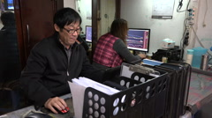 China, small scale local investors, trading online, speculation, stock exchange Stock Footage