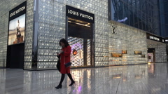 China shopping luxury brands Louis Vutton wealthy rich modern lifestyle Stock Footage