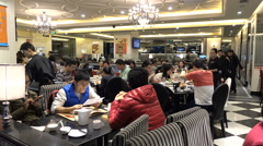 China modern restaurant, people eating dinner, middle class, lifestyle Stock Footage