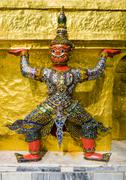 Red demon guardian supporting Wat Phra Kaew, Grand Palace, Bangkok, Thailand Stock Photos