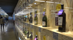 China advertising wall, wine bottles, middle class, consumption economy Stock Footage