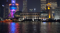 Illuminated buildings, neon lights, evening, reflection, Pudong, Shanghai Stock Footage