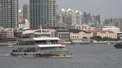 Chinese ferry vessel sails through downtown central Shanghai city Stock Footage