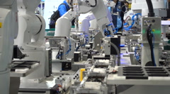 Assembly line robots on display at a technology fair in Shanghai, China Stock Footage