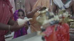 Young indian girl at Hare Krishna ceremony - stock footage