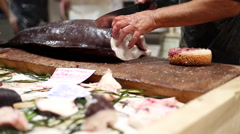 Fishmonger slicing a raw amber jack in a fish market in Cagliari, Sardinia. Stock Footage