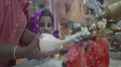 Indian girl at religious ceremony - stock footage