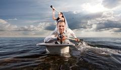 The bride and groom in a honeymoon cruise - stock photo