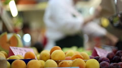 Shopping in a fruit market with peaches in a stall in Cagliari, Sardinia, Italy. Stock Footage