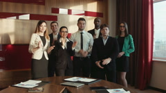 Successful business group applauding - stock footage