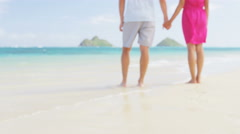 Holding hands romantic couple background on beach on travel summer vacation Stock Footage