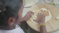 Adorable indian girl forming dough Stock Footage