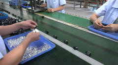 People at work on the production line of an electronics factory in China - stock footage