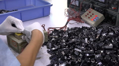 Quality control in Chinese electronics factory, industrial China Stock Footage