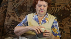Elderly woman tonometer measures the pressure electronically Stock Footage