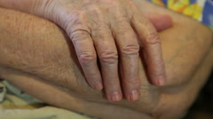 The folded hands of the elderly woman close-up Stock Footage