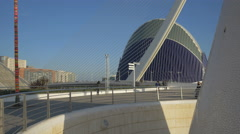 People walking on Assut de l'Or Bridge near the L'Àgora, Valencia Stock Footage