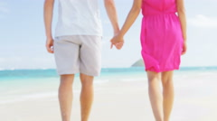 Romantic beach couple holding hands on honeymoon travel summer vacation Stock Footage