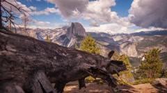 Clouds rise from behind epic Half Dome in beautiful Yosemite Stock Footage