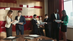 Group of successful businessmen discuss Stock Footage