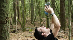 Thirsty Hiker Getting last Drop of Water - stock footage