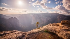 Sunset over epic Yosemite Valley with Sunbeams moving through the clouds Stock Footage