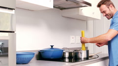 Handsome man cooking pastas in the kitchen Stock Footage