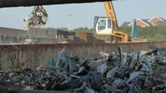 Crane Dropping Rubbish Into Scrap Heap Stock Footage
