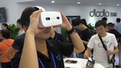 China technology trade show, virtual reality glasses, entertainment, Asia, man Stock Footage