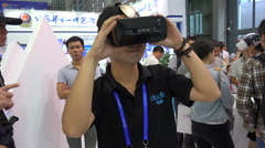 China trade show, virtual reality glasses, VR, gaming, entertainment, tech Stock Footage