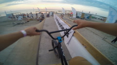 Bmx Rider removing on Video Himself during riding a bicycle. Close-up Of - stock footage