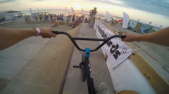 Close-up Of Handlebar Bike. Man Jumping And Riding on A BMX Bike in A Ramp. - stock footage