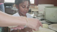 Young adopted indian girl cooking with her father Stock Footage
