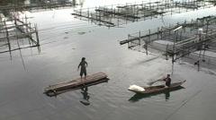 Fishermen catch fish traps empty Stock Footage