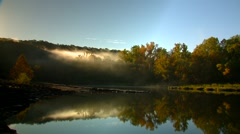 View of forest near lake at sunrise, Arkansas, USA Stock Footage