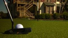 Golfer stroking golf ball into hole, Arkansas, USA - stock footage