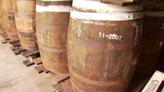 Stack of barrels at rum distillery warehouse Stock Footage