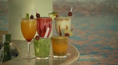 Glasses of cocktails kept on table near pool, Brazil Stock Footage