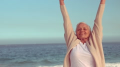 Happy senior woman raising hands Stock Footage