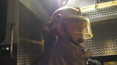 Profile of Fireman At Night By Fire truck Stock Footage