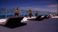 Sun loungers in beachside resort, Cancun, Mexico Stock Footage