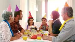 Cute family celebrating cute siblings birthday - stock footage