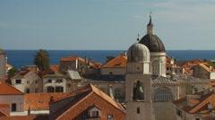 View of church bell tower and house roof in Croatia - stock footage