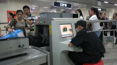 China security, subway passengers, checking luggage, X-ray machine, safety Stock Footage